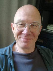 Portretfoto van Dick Koene, secretaris van de vereniging